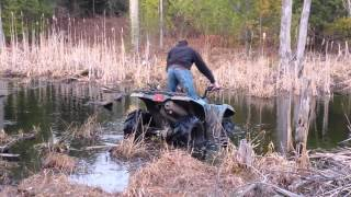 5. going through the swamp on a Yamaha Bruin 350 4x4 4 wheeler.