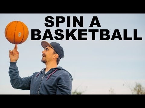 Guy Learns to Spin a Basketball for 30 seconds
