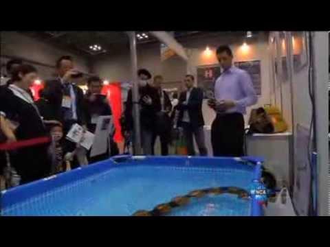 Exhibitors show off their gadgets at robot trade fair