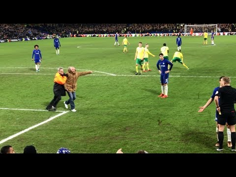 Morata red card. Chelsea fan on pitch confronts ref. Norwich player hands fan his dropped cigarettes.