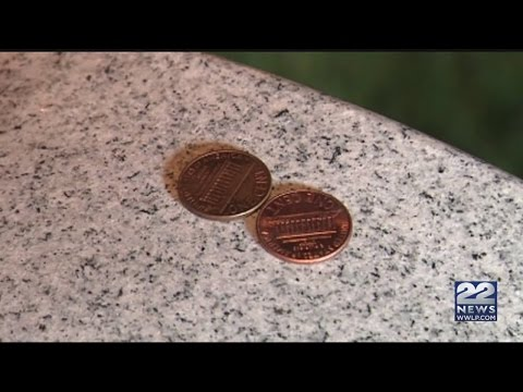 If you see coins on a military tombstone, do not take them