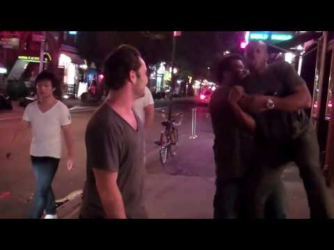 3 guys on the street out front of the Comedy Cellar reenacting Rocky 1-6