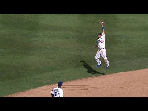 COL@LAD: Barney jumps to rob Culberson of a hit