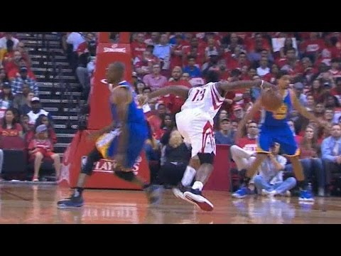 James Harden crosses over Andre Iguodala