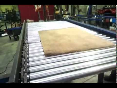 Test aligning carpets on driven roller conveyor