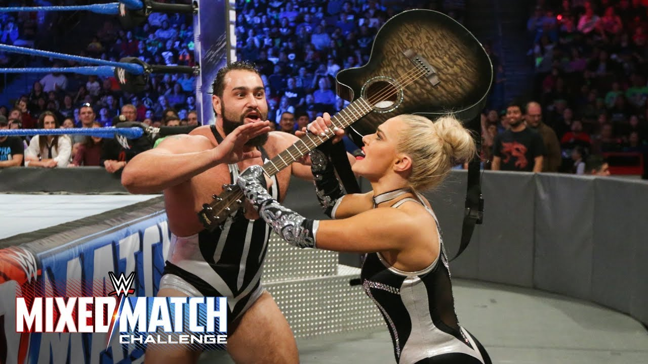 Lana charges the ring with a guitar on WWE Mixed Match Challenge