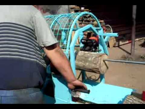 Ukrainian hydraulic firewood processor (chain saw machine)