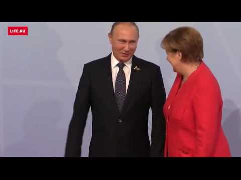 Как Меркель встретила Путина и Трампа на G20 (видео)