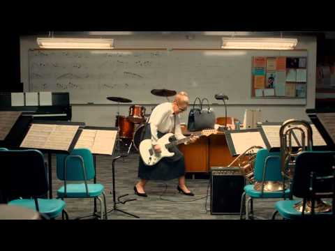 #LitaFord in a TV commercial playing a rockin music teacher