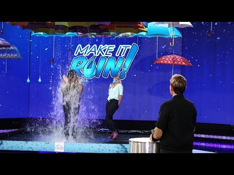 Two Fans Suit Up for a Game of 'Make It Rain'!