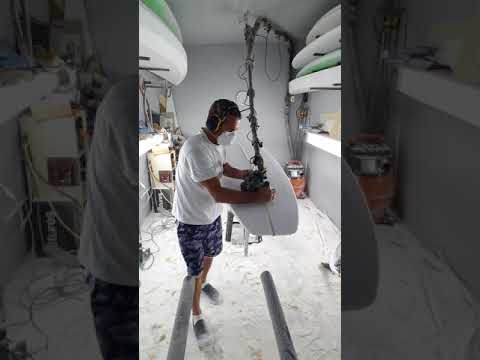 Ruffffff shaping a 9'4″ longboard.
