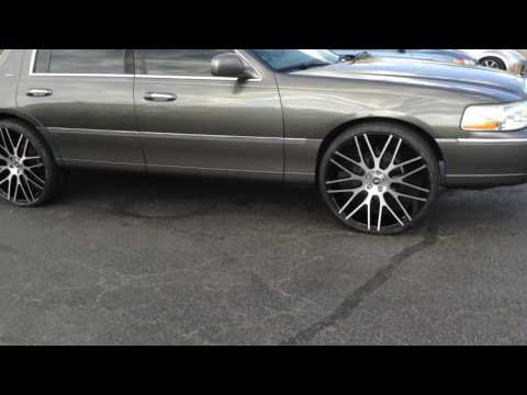"""2004 Lincoln Towncar  sitting on 24"""" Spec-1 SPL- 001 Wheels with 255/30-24 Lexani Tires."""