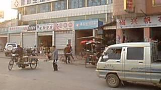preview picture of video 'Traffic Flow in Putian, (Fujian Province) China in 2005'