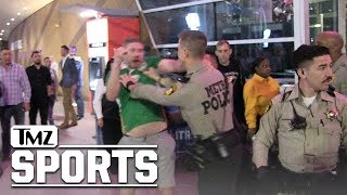 Fans Fight and Confront Cops After Khabib/McGregor UFC 229 Fight | TMZ Sports