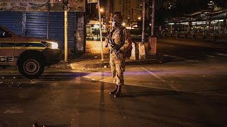 "South African police service arrest people for defying a nationwide lockdown in Johannesburg Friday.   The security personnel have been deployed to enforce the lockdown in a bid to curtail spread of COVID-19.  Nearly 57 million people are to be confined to their homes for three weeks.  President Cyril Ramaphosa personally visited soldiers at a military base in Soweto Township prior to their deployment.  ""I am sending you to go and defend our people against coronavirus,"" Ramaphosa said.  ""This is… READ MORE : http://www.africanews.com/2020/03/27/south-africa-military-arrest-lockdown-breakers  Africanews on YouTube brings you a daily dose of news, produced and realised in Africa, by and for Africans. Africanews is the first pan-African multilingual media outlet, unique in its concept and vision. Subscribe on our Youtube channel https://www.youtube.com/c/africanews and receive all the latest news from the continent.  Africanews is available in English and French. Website : www.africanews.com Facebook : https://www.facebook.com/africanews.channel/ Twitter : https://twitter.com/africanews"