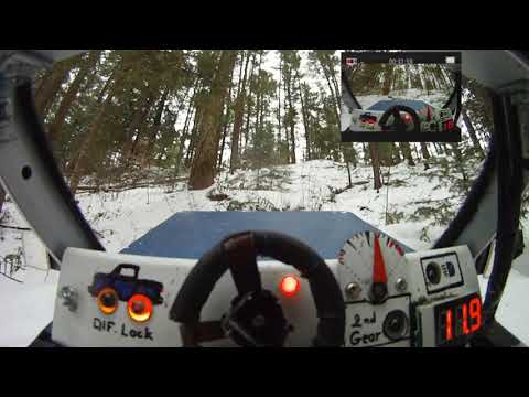 fpv-rc-car-traxxas-summit-4x4-in-wood-after-snowing