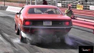 426 Hemi Cuda vs 426 Hemi Coronet R/T - 1/4 mile drag race video - Road Test TV