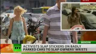 Activists slap giant stickers on badly-parked cars to shame their owners