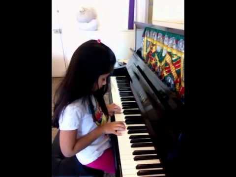 Janita playing Do Re Me on the Piano