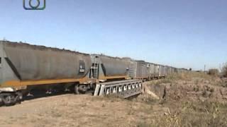 preview picture of video 'Tren granero de NCA cruzando el Arroyo de Tegua'