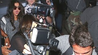 Photographers Trip Over Selena Gomez At LAX