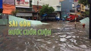 Nước cuồn cuộn khắp Sài Gòn sau cơn mưa lớn