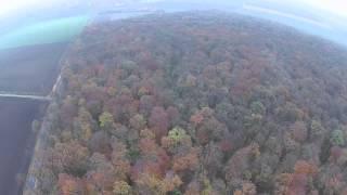 preview picture of video 'Borsum von oben - Sportplatz im herbstlichen Wald'