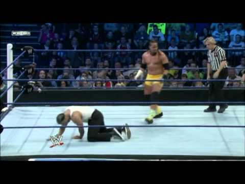Jey Uso - Twisting Forearm Smash Followed By Running Corner Hip Attack