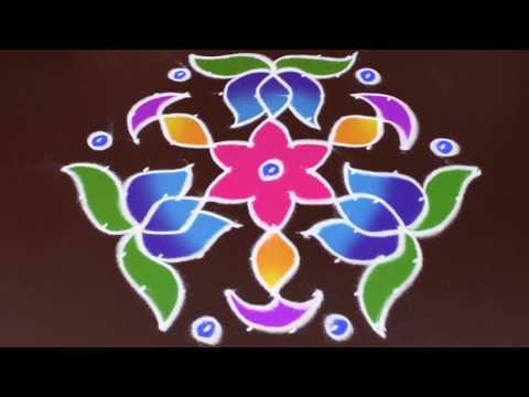 lotus with deepam rangoli art   11 to 6 interlaced dots rangoli   lotus kolam by sunitha