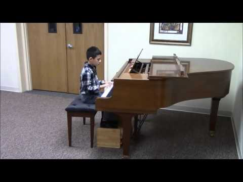 Student Aaron in his Suzuki Piano Book 2 recital.
