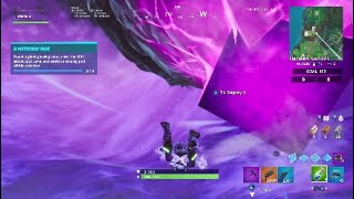 Touch a giant glowing cube, enter the Rift above Loot Lake, and search a landing pod within a meteor