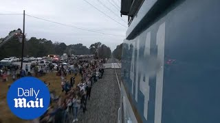 Thousands farewell George H.W. Bush on funeral train route