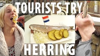 Tourists Try Dutch Herring