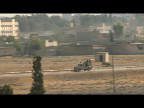 Turquie: la fumée s'élève au-dessus de la ville frontalière Tal Abyad | AFP Images Turquie: la fumée s'élève au-dessus de la ville frontalière Tal Abyad | AFP Images