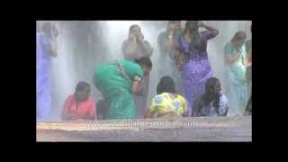Even saree-clas women have the right to get wet and bathe under a waterfall