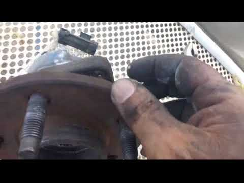 How to replace the front hub assembly on a 2002 Pontiac Bonneville