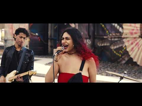 student and singer/songwriter Cindy Latin in her original composition and music video