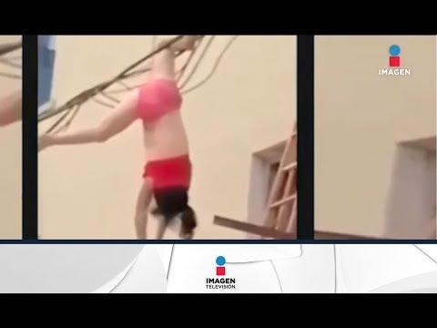 Amante queda colgada de los cables al intentar escape por la ventana | Imagen Noticias