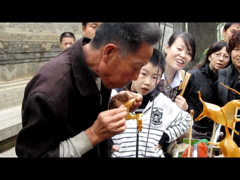 Download Candy Blowing by Street Artist in Xian, China HD Mp4 3GP Video and MP3