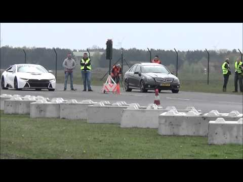 Bmw I8 Tuned By Manhart Races Mercedes Benz C63 Amg And