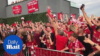 Liverpool fans cheer as Mo Salah penalty gives their team the lead