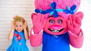 Nastya sings a nursery rhyme song Peek-a-boo with her funny friend troll and pretend play