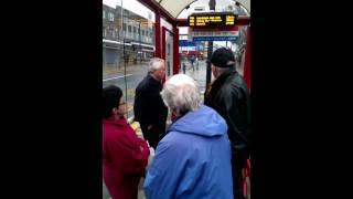 Hilarious argument between two old English people at a bus stop