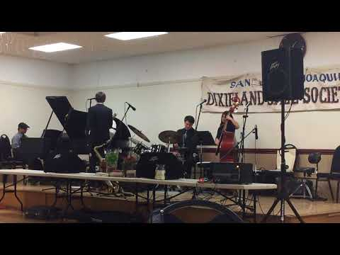 William plays guitar with Parker and the Weis Guys at the Elks Lodge.