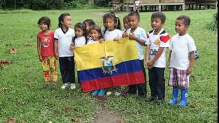 Native children performing what they know of the ecuadorian national anthem