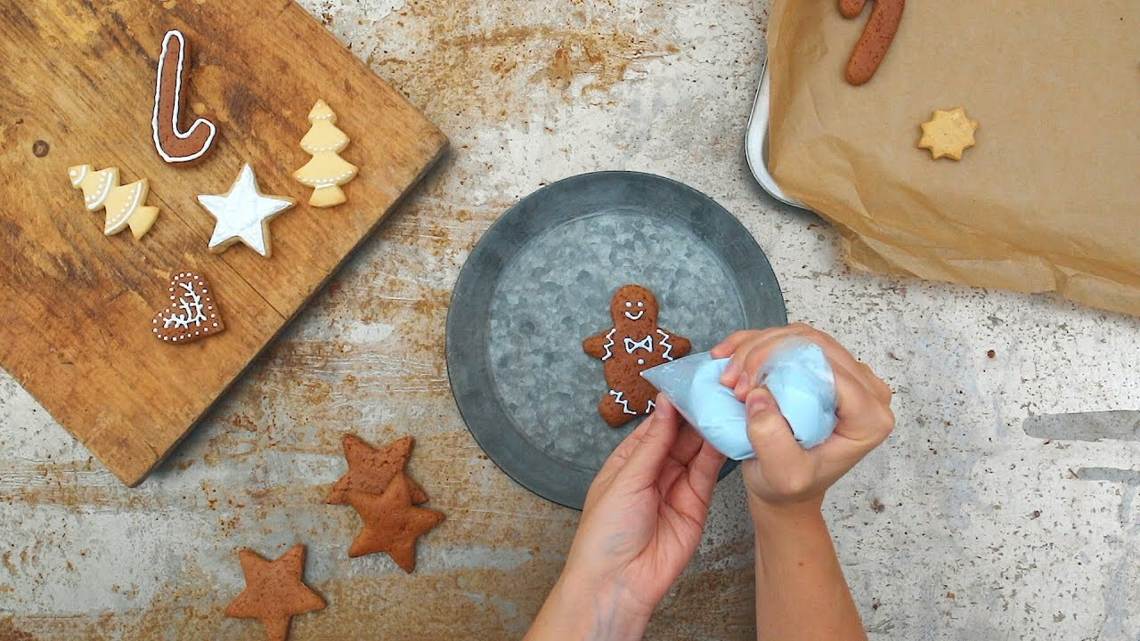 Decorate biscuits with icing