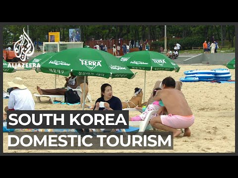 South Korea reopening: Domestic tourists flock to Busan's beaches