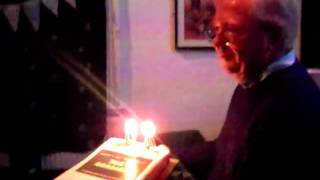 Tim Brooke-Taylor blows out the candles