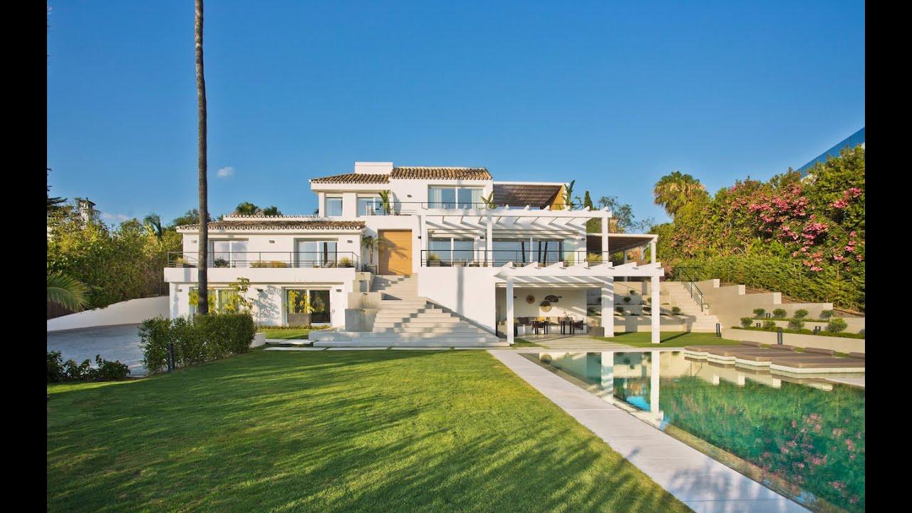 Striking contemporary villa facing unobstructed golf views for sale in Nueva Andalucia, Marbella