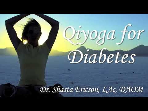 3 women sitting on mat one doing diabetec exercises
